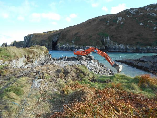 Excavator working on new slip  Cape Clear